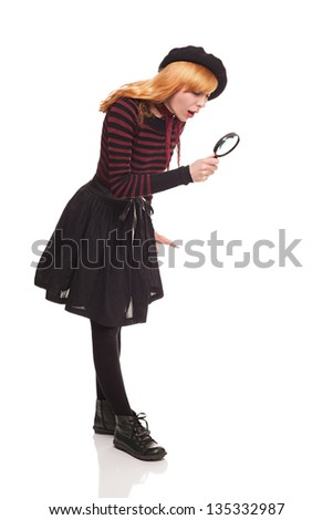 young lady looking at something with magnifying glass isolated on white background