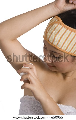 Young lady putting deodorant under her arms