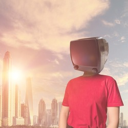 Young lady with a vintage TV instead of a head against the backdrop of a metropolis at sunset. Addiction to television. Modern businessman on the background of the city. Obsolescence of business mode