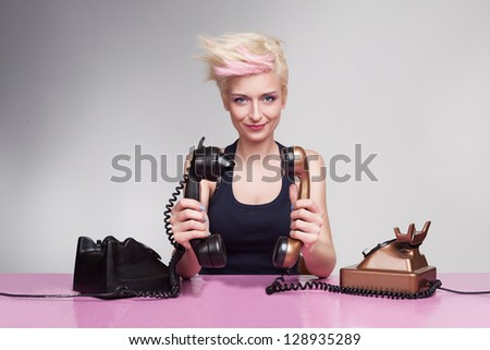 young lady with crazy hair holding handset to each other and having fun