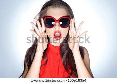 Young lady with huge sunglasses on white