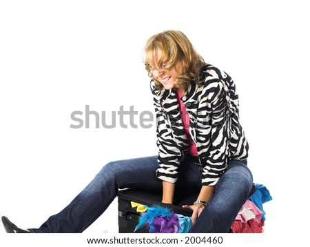 young lady with suitcase packing  for travel