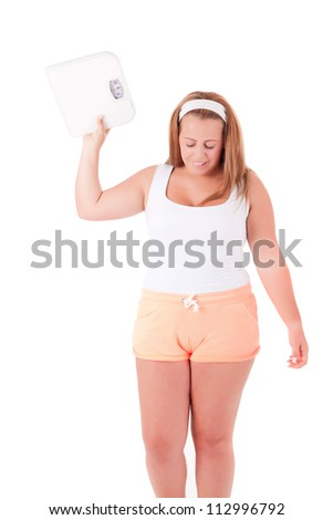 Young large woman with a scale - Diet Concept - stock photo