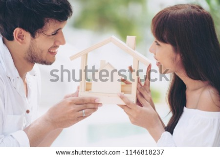 Young Latin couple planning to buy a house and have happy family.