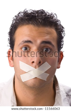 Young latin man with masking tape on mouth. Isolated in white background - stock photo