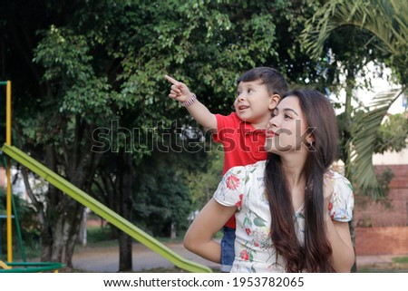 Young latin mother has fun with her son in a park child happy mother happy mother's day Stock fotó ©