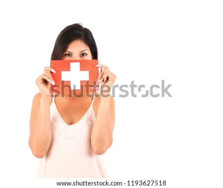 Young latin woman holding the flag of Switzerland against a white background #1193627518