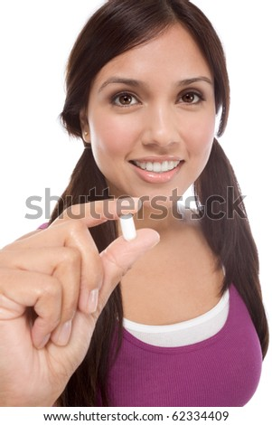 Young Latina woman showing white medication tablet