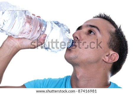young Latino drinking water from a bottle