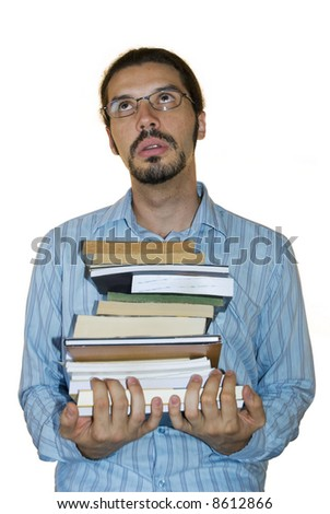 Young latino man rolling his eyes, holding a stack of books. White background.