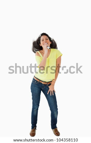 Young Latino student singing while shaking her head against white background