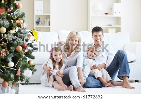 Young laughing family home with spruce