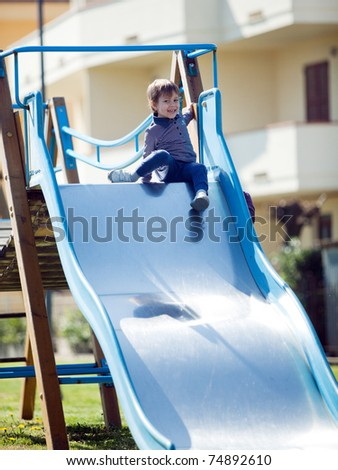 Young little girl having fun in the park