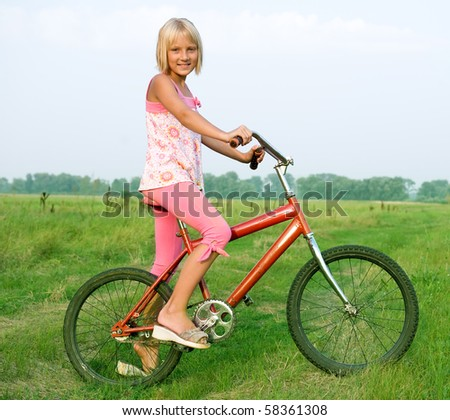 Young little girl on bicycle outdoors