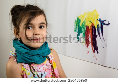 young little girl portrait painting on wall