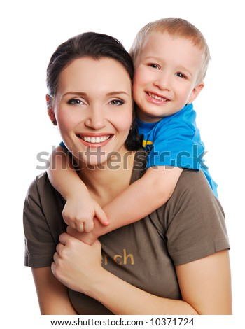 young little son embracing his pretty young mother