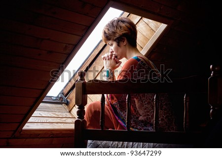 Young lonely woman suffering from a severe depression.