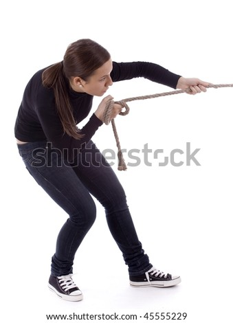 young long hair girl pulling grey rope, tug-of-war