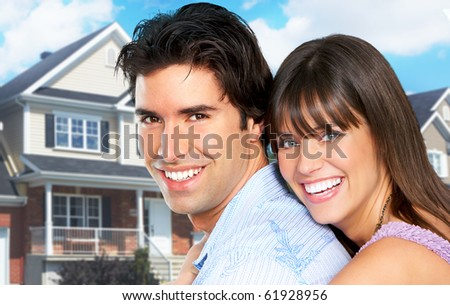 Young love couple a new home.  Real estate concept