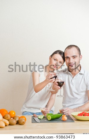 Young love couple cooking. Big copyspace