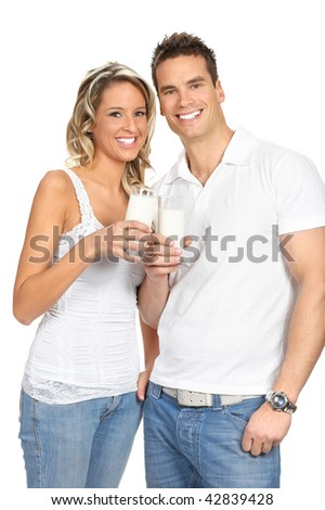 Young love couple  drinking milk. Over white background