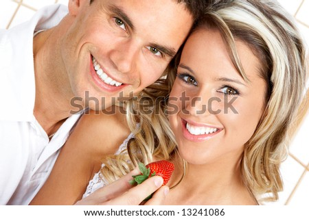 Young love couple eating strawberries. Over white background #13241086