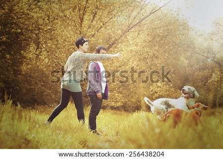 young love couple man and woman on walk with dog in autumn nature