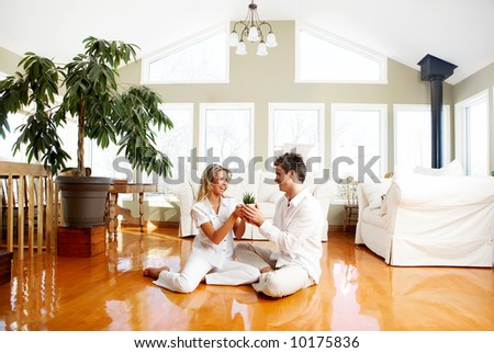 Young love couple smiling in the comfortable apartment #10175836