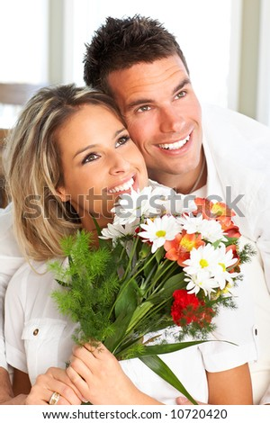 Young love couple smiling in the comfortable apartment #10720420