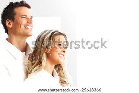 Young love couple smiling in the comfortable apartment