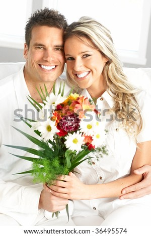 Young love couple smiling in the comfortable apartment #36495574