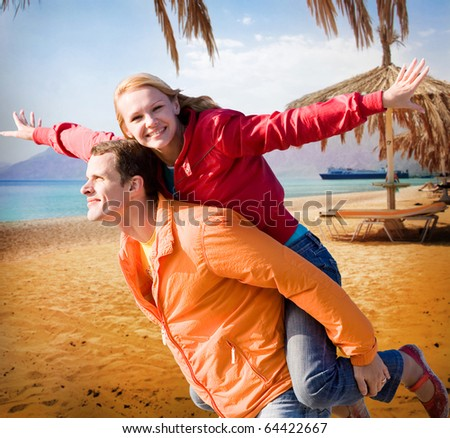 Young love Couple smiling under beach