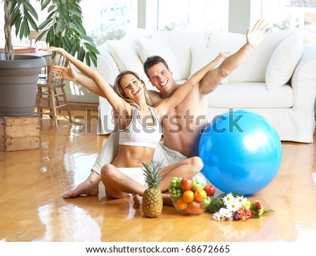 Young love couple with fruits in the comfortable apartment