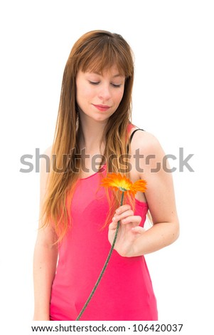 Young lovely smiling woman wonders on flower
