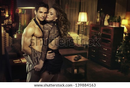 Young lovers in a beautiful home interior