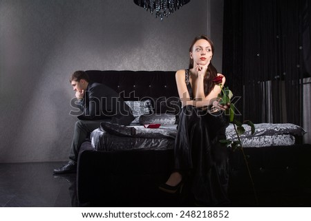 Young Lovers in Formal Wear Fighting for Something While Sitting at the Bedroom