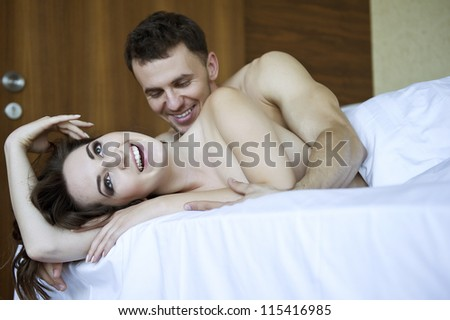 Young lovers lay in bed