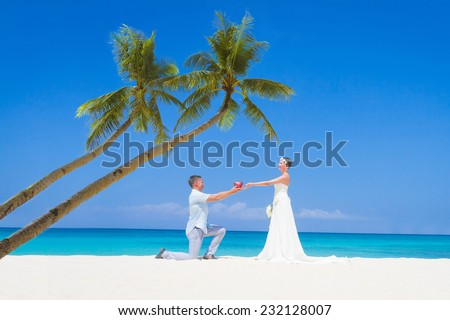 young loving couple bride and groom, on wedding day on tropical sand beach, beach wedding concept