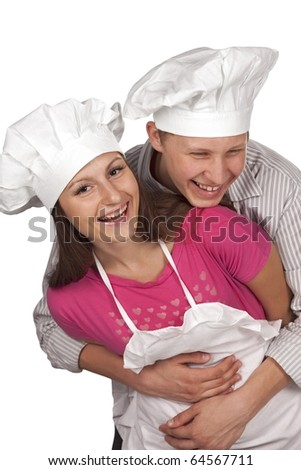 Young loving couple cooks. Over white background