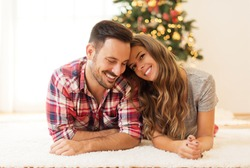 Young, loving couple enjoying on a Christmas morning