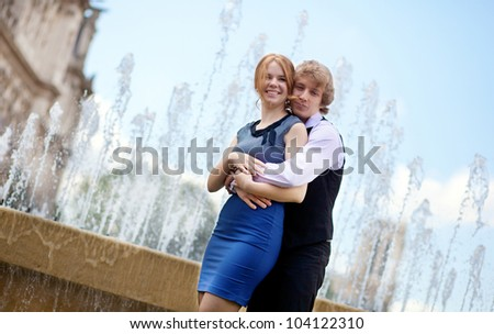 Young loving couple in Paris by the fountain