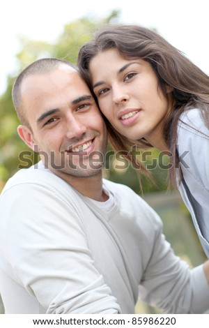 Young loving couple in town