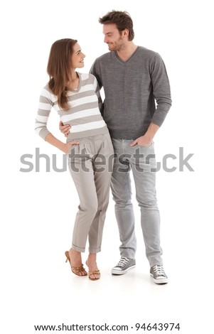 Young loving couple looking at each other, smiling, hugging.?