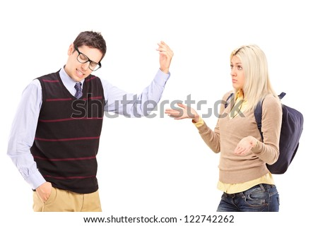Young male and female student arguing isolated on white background