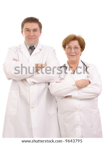 Young male and senior female doctors standing side by side over white background - stock photo