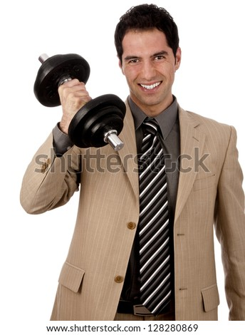 Young male businessman in light suit with power lifts a dumbbell and shows strength and determination, isolated against white background