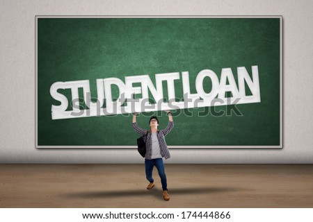 Young male college student holding a sign of student loan