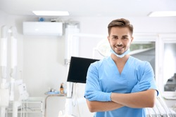 Young male dentist in clinic