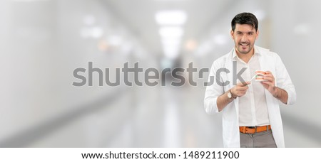 Young male dentist working in dental clinic. Dentistry care and medical service concept.
