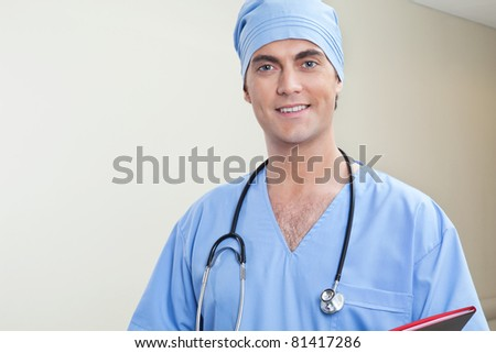 Young male doctor in hospital corridor - stock photo